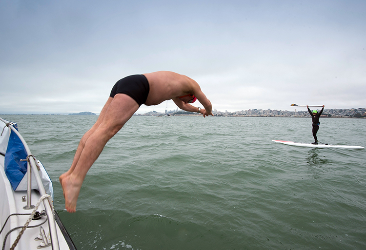 swimmer-jumping in the bay